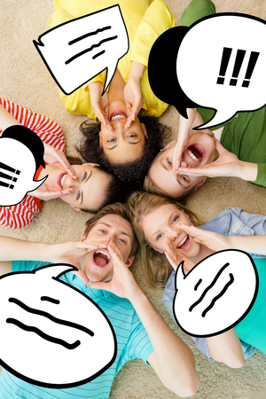 friendship, lifestyle and happiness concept - group of young smiling people lying on floor in circle screaming and shouting photo