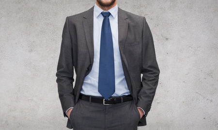 gray suit: business and office concept - handsome buisnessman in suit Stock Photo