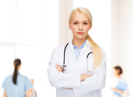 healthcare and medicine concept - serious female doctor with stethoscope photo