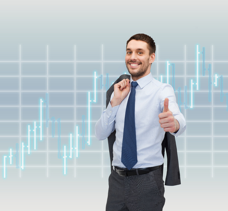 business, office, gesture and people concept - smiling young and handsome businessman showing thumbs up over forex chart background photo
