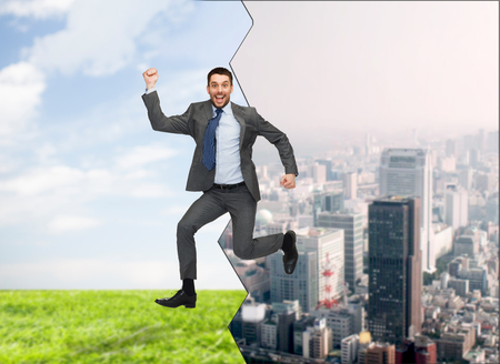 business, education and people concept - smiling happy businessman jumping photo