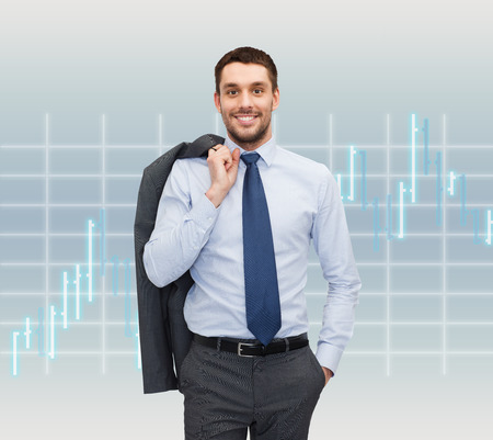 business and people concept - smiling young and handsome businessman over forex chart background photo