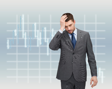 business, education and office concept - handsome businessman having headache over forex chart background over forex chart background photo