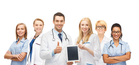 modern doctor: medicine, technology and healthcare concept - team or group of doctors and nurses with tablet pc computer blank screen showing thumbs up