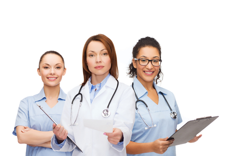 hospital staff: healthcare and medicine concept - calm female doctor adn nurses with clipboard and stethoscope giving prescription