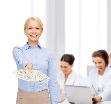 cash money: business and money concept - smiling businesswoman with dollar cash money