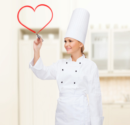 virtual assistant: cooking, new technology , advertisement and food concept - smiling female chef with marker writing something on virtual screen