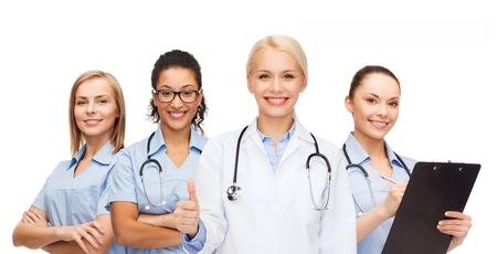 clinical staff: medicine and healthcare concept - team or group of doctors and nurses showing thumbs up Stock Photo