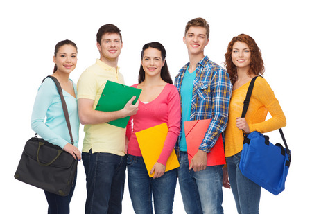 friendship, youth, education and people concept - group of smiling teenagers with folders and school bags photo