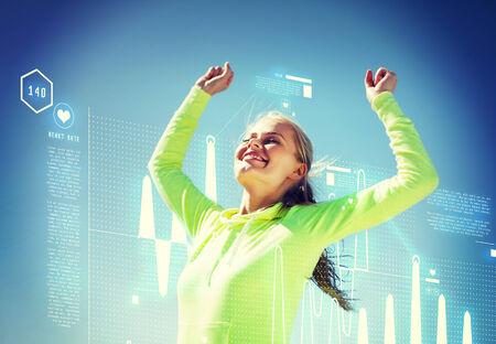 Sport en lifestyle concept - vrouw runner vieren overwinning Stockfoto