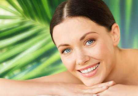 nice body: health and beauty, resort and relaxation concept - woman in spa salon lying on the massage desk Stock Photo