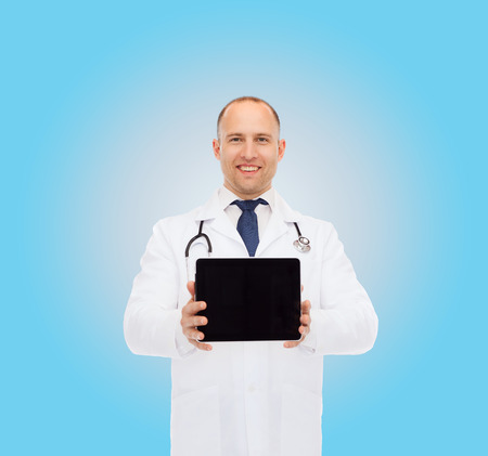 commercial medicine: medicine, profession, advertisement and healthcare concept - smiling male doctor with tablet pc computer and stethoscope over blue background