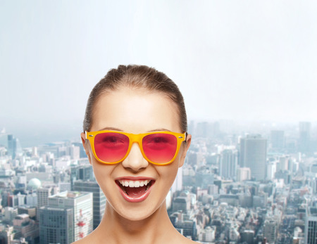 teenage girl happy: happiness and people concept - portrait of happy teenage girl in pink sunglasses