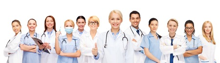 mentors: medicine and healthcare concept - team or group of doctors and nurses showing thumbs up Stock Photo