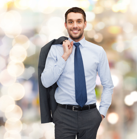 corporative: business and people concept - smiling young and handsome businessman Stock Photo