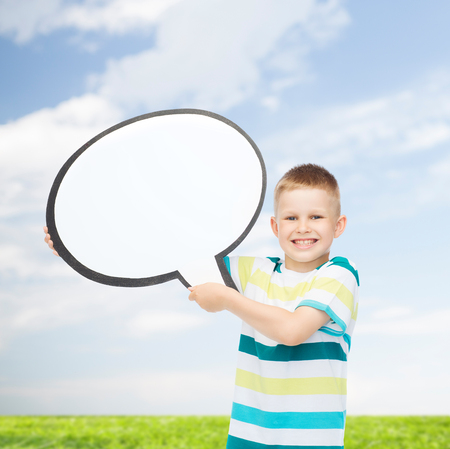 comments: happiness, childhood, conversation, environment and people concept - smiling little boy with blank text bubble over natural background