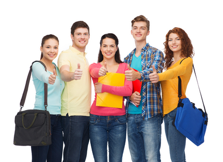 friendship, youth, education and people concept - group of smiling teenagers with folders and school bags showing thumbs up photo