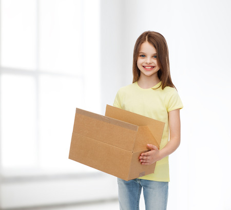 delivery room: advertising, childhood, delivery, mail and people - smiling little girl holding open cardboard box over white room background