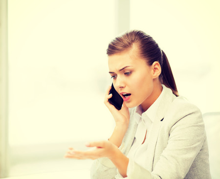bright picture of woman shouting into smartphone photo