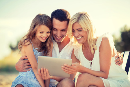 summer holidays, children and people concept - happy family with tablet pc taking picture Foto de archivo