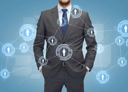 linkage: business, people and global connection concept - close up of businessman over blue world map and human icons background