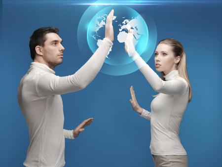future, technology, business, education and people concept - man and woman working with globe hologram photo