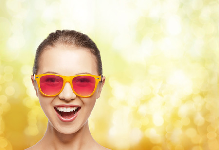 happiness and people concept - portrait of happy teenage girl in pink sunglasses photo
