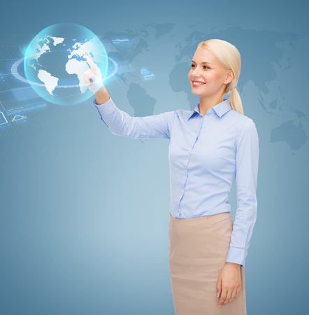 business, future, education and technology concept - smiling young businesswoman or student working with virtual screen photo
