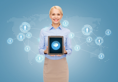 business, technology and internet concept - smiling businesswoman showing tablet pc computer screen with message bubble icon photo