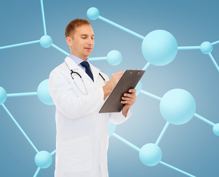 medicine, biology, chemistry and people concept - smiling male doctor with clipboard and stethoscope writing prescription over molecular background photo