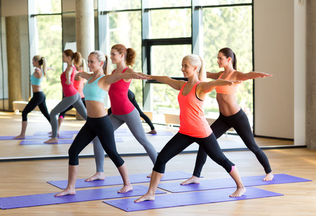 fitness, sport, training and lifestyle concept - group of smiling women stretching in gym Фото со стока - 30906817