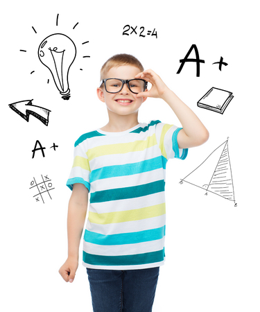 vision, education and school concept - smiling little boy in eyeglasses over white background
