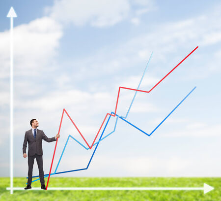 business, development and people concept - smiling man holding graph line over chart background photo