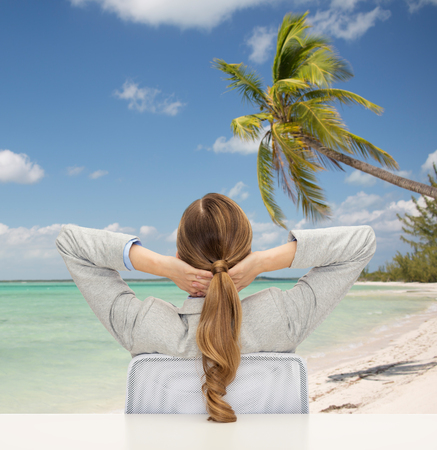 business, travel, tourism, vacation and people concept - businesswoman or teacher sitting on chair from back over tropical beach background 版權商用圖片