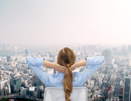 executive chair: business, building, development and office people concept - businesswoman sitting on chair from back over city background