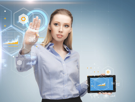 sci fi: business, future technology, development and people concept - young businesswoman working with tablet pc and graph projections Stock Photo