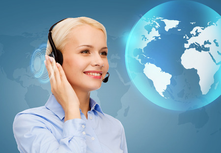business, technology and call center concept - friendly female helpline operator with headphones photo