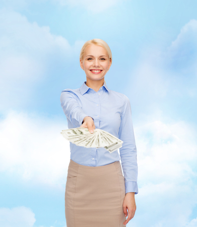 business and money concept - smiling businesswoman with dollar cash money photo