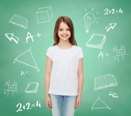 advertising, school, education, childhood and people - smiling little girl in white blank t-shirt over green board with doodles background photo