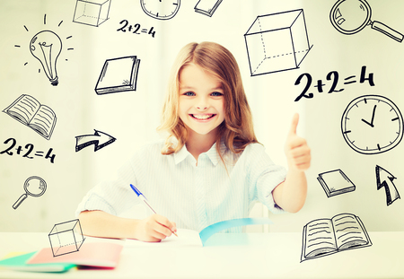 education and school concept - smiling student girl studying at school photo