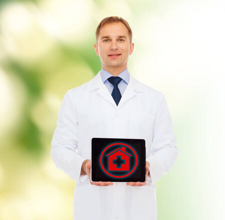 medicine, profession, environment and healthcare concept - smiling male doctor with tablet pc computer over natural background photo