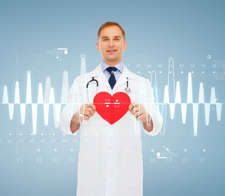 medicine, profession, and healthcare concept - smiling male doctor with red heart and stethoscope photo