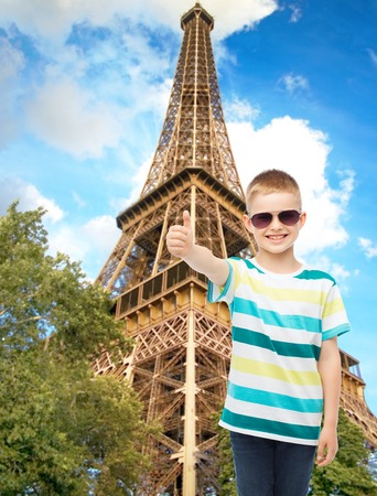 happiness, summer, childhood and people concept - smiling cute little boy in sunglasses photo