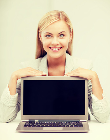 education,business, technology and internet concept - smiling woman with laptop pc photo