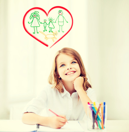 education, creation and school concept - smiling little student girl drawing and daydreaming at school photo