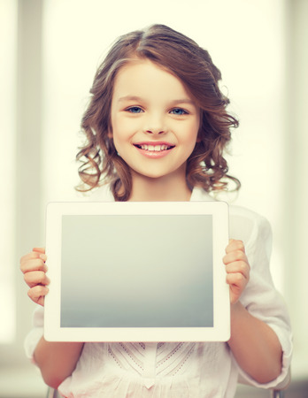 pre teen girl: picture of beautiful pre-teen girl with tablet pc
