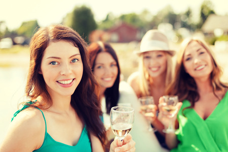 sightseeing tour: summer holidays, vacation and celebration concept - smiling girls with champagne glasses Stock Photo