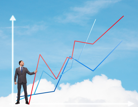 business, development and people concept - smiling man holding graph line over chart and blue sky background photo