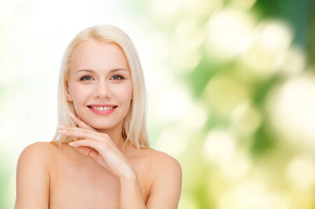 eco sensitive: health and beauty concept - face and hands of beautiful woman Stock Photo