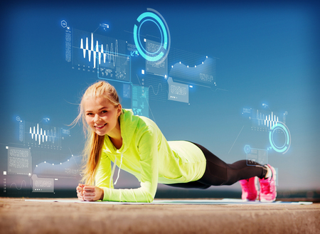 heart rate: sport and lifestyle concept - woman doing sports outdoors Stock Photo